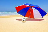Parasol with ball at the beach Royalty Free Stock Images