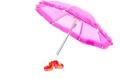 Parasol bastante rosado con dos corazones Fotografía de archivo