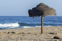 Parasol in beach and Atlantic ocean view from Tavira island Stock Image