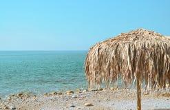 Parasol on the coast. Palm beach umbrellas at the beach Royalty Free Stock Image