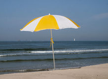 Parasol on the beach Stock Images