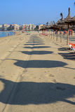 Parasol beach. CAN PASTILLA, MAJORCA, BALEARIC ISLANDS, SPAIN - JULY 24, 2013: Parasols and lounges on sandy beach on a sunny summer morning on July 24, 2013 in Stock Photos