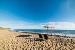 Parasol and beach chairs in Malibu Stock Photos