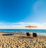 Parasol and beach chairs in Malibu. California Royalty Free Stock Image