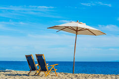 Parasol and beach chairs in Malibu. California Stock Images