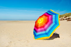 Parasol at the beach. Colorful parasol at the summer beach Stock Photography