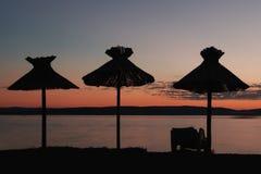 Parasol on the beach. Sunset Stock Photo