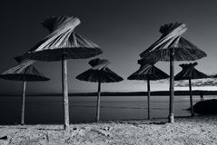 Parasol on beach. Parasol on tropical beach black and white Royalty Free Stock Image