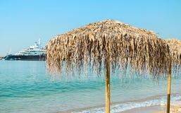 Parasol on the coast. Beach umbrellas at the beach Royalty Free Stock Image