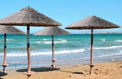 Parasols on the beach. Beach umbrellas at the beach Royalty Free Stock Photography