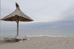 Parasol on beach in Vama Veche Royalty Free Stock Image