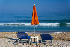Parasol and beds on the beach Royalty Free Stock Photo