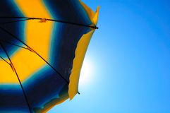 Parasol and blue sky Stock Image