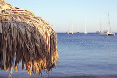 Parasol and Calm Sea. Parasol and in the distance, calm sea and yachts Stock Photo