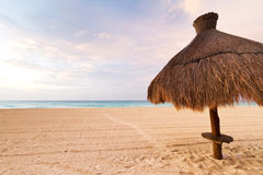 Parasol at Caribbean Sea. At sunrise Royalty Free Stock Photo
