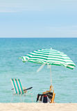 Parasol and chair. Lonely beach. Royalty Free Stock Images