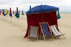 Parasol with chairs on the beach Stock Photos