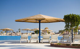Parasol and chaise-longue in hotel Royalty Free Stock Photos