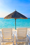 Parasol and chaise lounges. Maldives stock photography