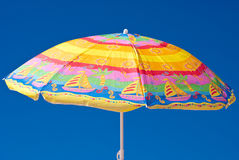 Parasol. Colorful parasol at the background of blue sky Royalty Free Stock Photo