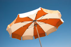 Parasol. Colorful umbrella on the blue sky background Royalty Free Stock Image