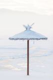Parasol covered with snow on the beach in the winter Stock Photo