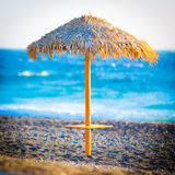 Parasol. Dawn with parasol and palms by the ocean Stock Photos