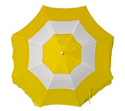 Parasol de playa con las rayas amarillas y blancas Foto de archivo