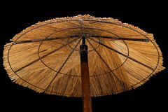Parasol de playa de la paja Foto de archivo