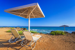 Parasol and deckhcair on the Banana Beach of Zakynthos. Island, Greece Stock Image