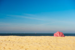 Parasol at the empty beach Royalty Free Stock Photography