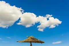 Parasol. Exotic parasol on a beach Stock Photos