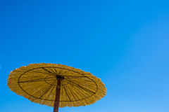 Parasol. Exotic parasol on a beach stock image