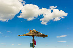 Parasol. Exotic parasol on a beach Royalty Free Stock Images