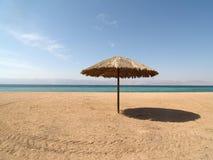 Parasol on the Jordan beach Royalty Free Stock Photography