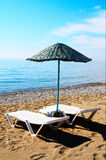 Parasol and lounge-chairs on the beach resort. Royalty Free Stock Images