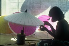Parasol Maker. A girl making parasols in Chiang Mai, Thailand Stock Photos