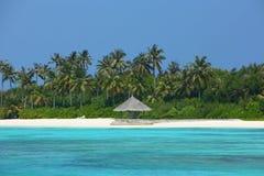 Parasol on Maldives beach. Maldives beautiful beach in the morning Royalty Free Stock Photos