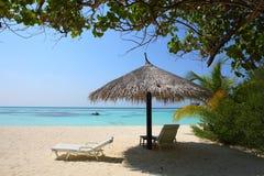 Parasol on Maldives beach. Maldives beautiful beach in the morning Stock Photos