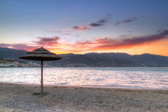 Parasol at Mirabello Bay at sunset. Greece Royalty Free Stock Image