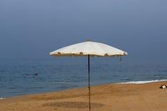 Parasol on a sandy beach. Ocean Royalty Free Stock Image
