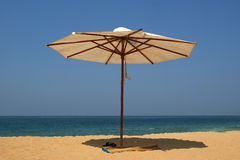 Parasol on a sandy beach. Ocean Stock Photo