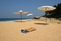 Parasol on a sandy beach. Ocean Stock Image