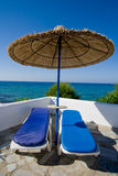 Parasol at seaside. Sunbathing under a parasol at seaside Royalty Free Stock Photo