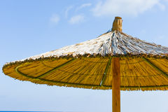 Parasol of straw on the sea Stock Photos