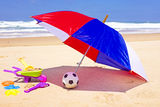 Parasol, toys and ball at the beach. In summer Royalty Free Stock Image