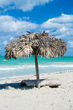 Parasol on the tropical sand beach Stock Image
