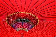 Parasol vermelho colorido Imagens de Stock Royalty Free