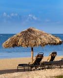 parasolowi bryczka plażowi hole Obrazy Stock