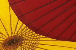 Parasols. Red and yellow colored beautiful parasols in bright sunlight in a Thai village royalty free stock photos